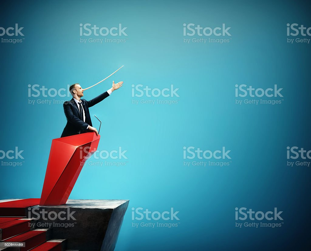Man in the suit with long nose. Concept of liar. stock photo