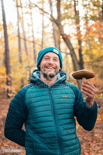 Smiling man on an autumn walk