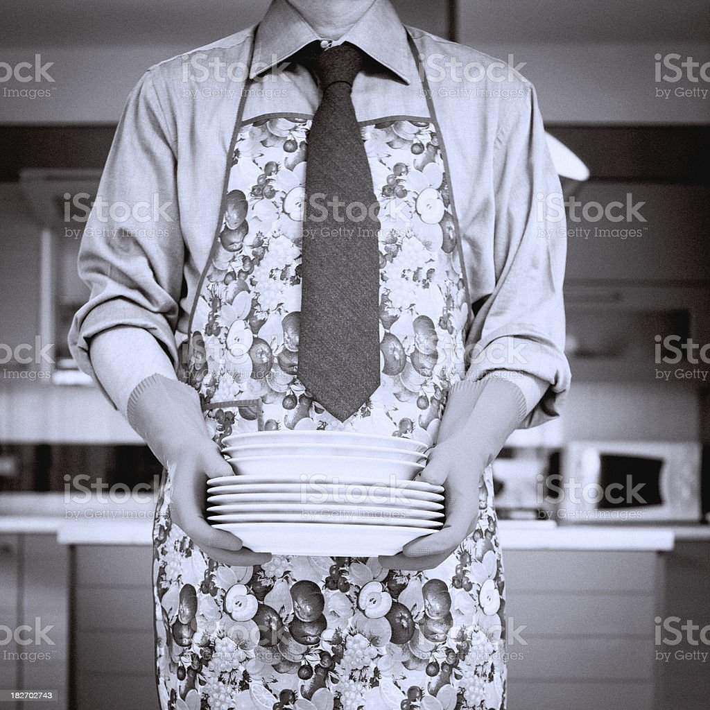 Man in Tie and Apron Carrying Dishes royalty-free stock photo