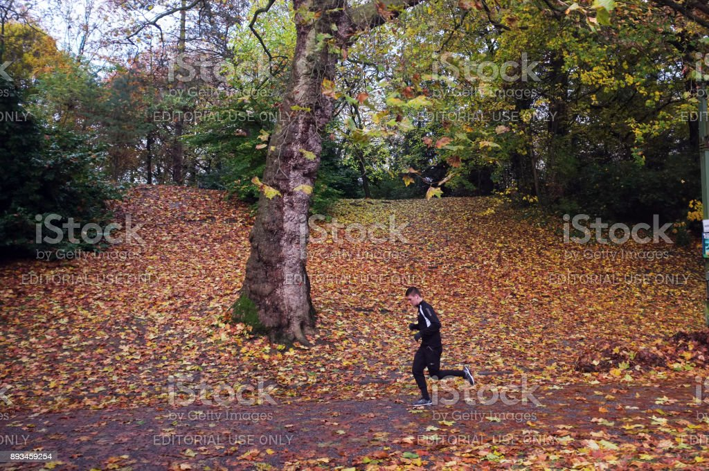 Man in track suit jogging stock photo