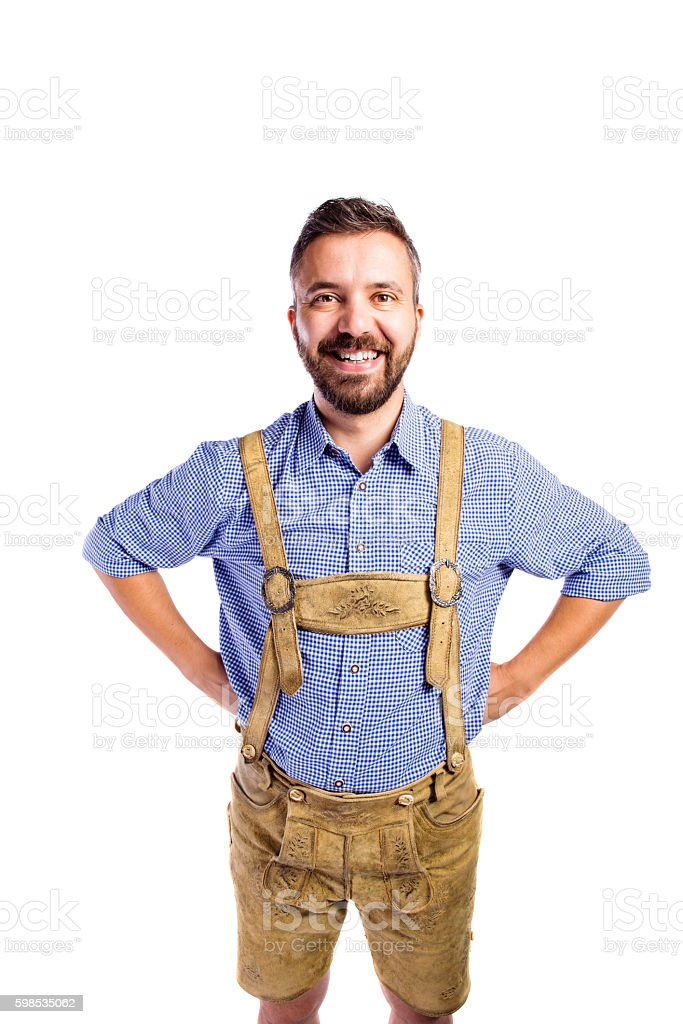 Man in traditional bavarian clothes, hands on hips photo libre de droits