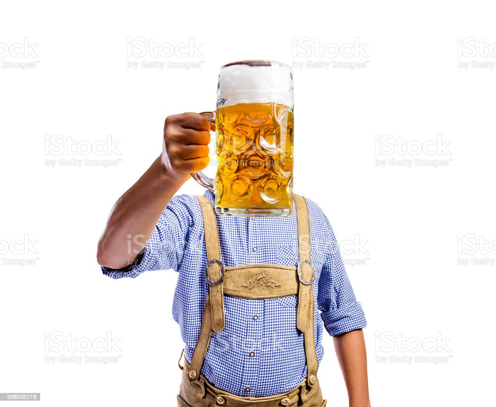 Man in traditional bavarian clothes holding mug of beer photo libre de droits