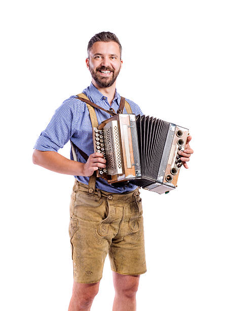 man in traditional bavarian clothes playing accordion. oktoberfe - accordion stock photos and pictures