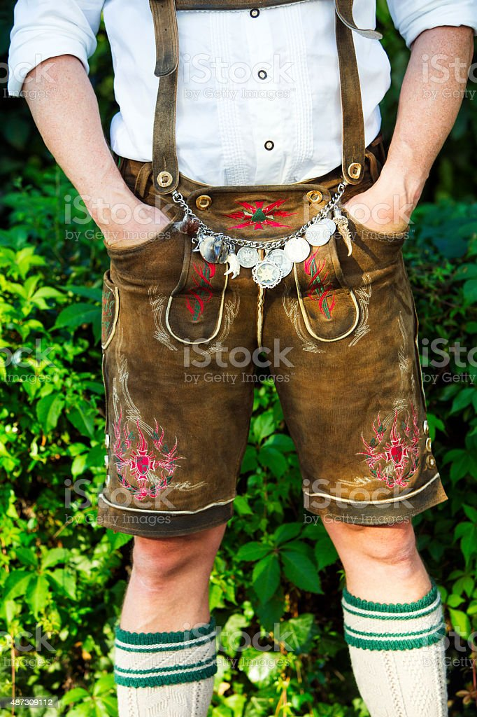 man in traditional bavarian leather pants stock photo