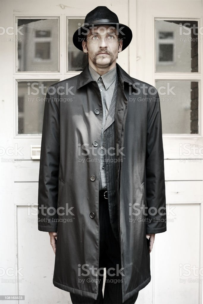 Man in Trench Coat and Hat stock photo