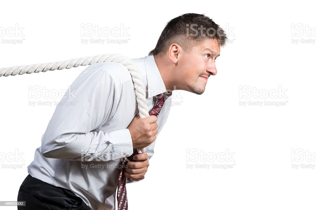 Man in tug of war concept on white stock photo