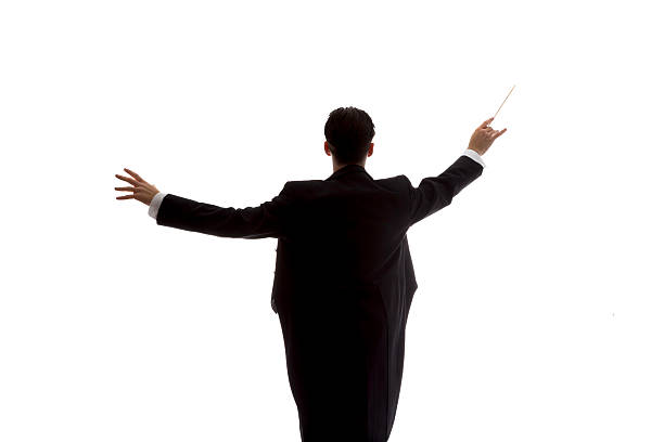 Man in tuxedo conducting - foto de stock