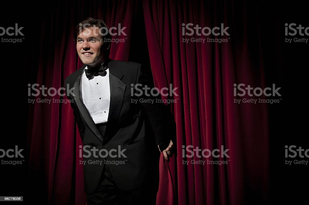 Man in tuxedo on stage royalty-free stock photo