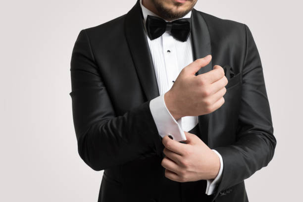 Man in tuxedo wearing cufflinks Man in tuxedo wearing cufflinks evening wear stock pictures, royalty-free photos & images
