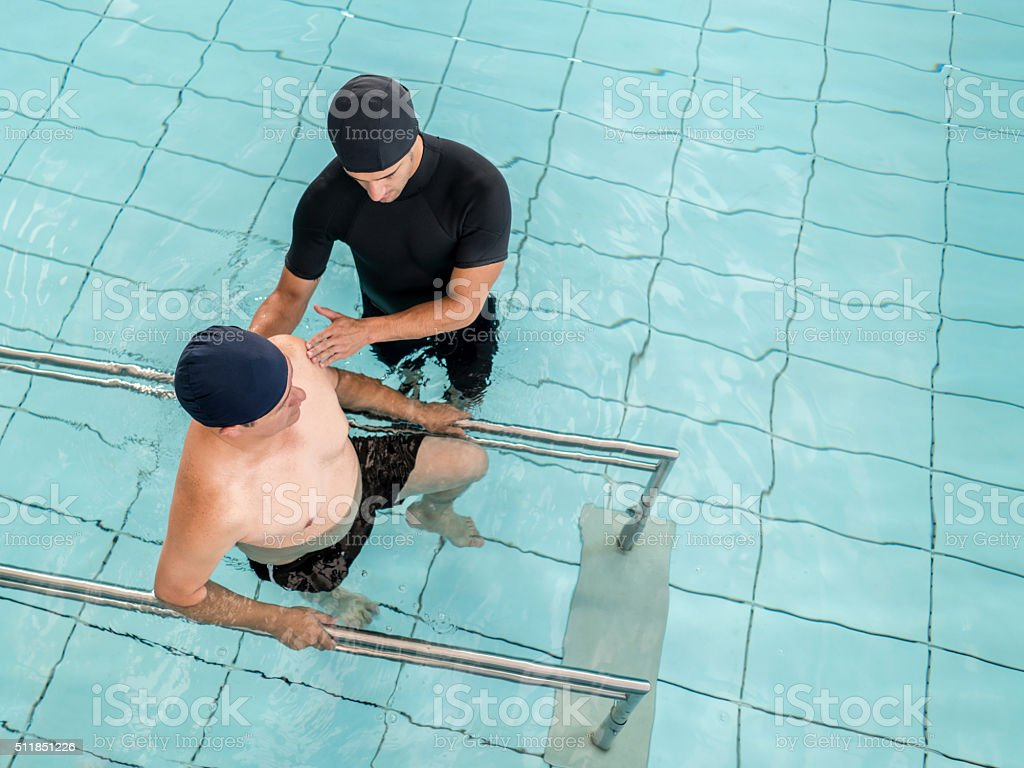 Man in underwater physiotherapy stock photo