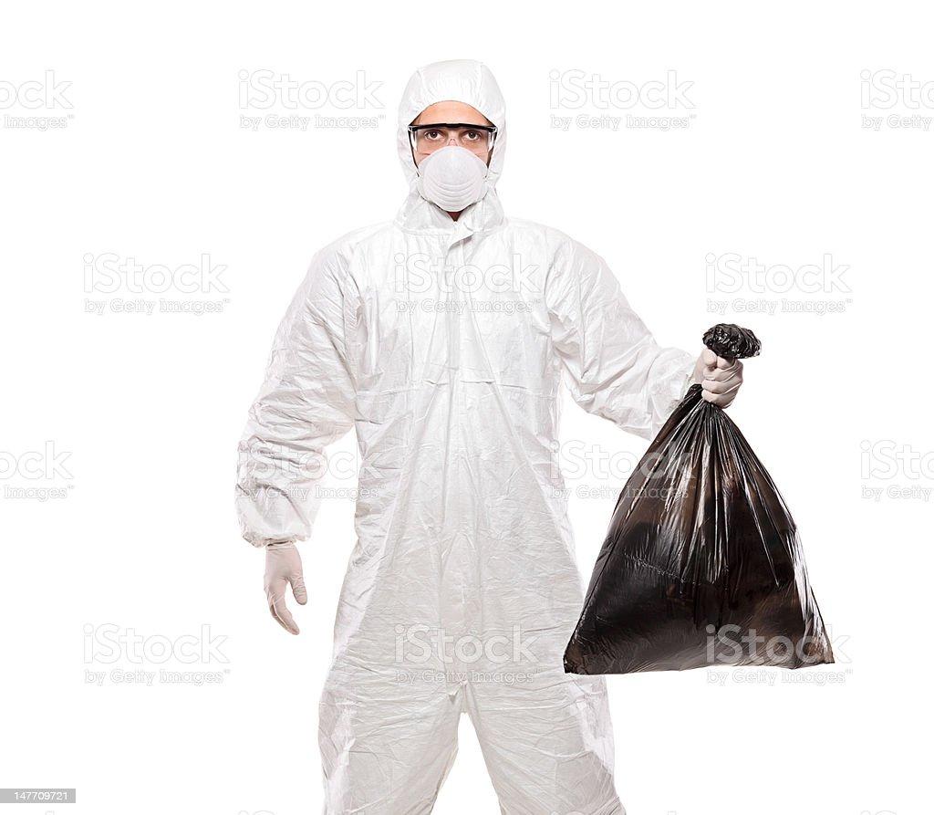 Man in uniform holding a black garbage bag royalty-free stock photo
