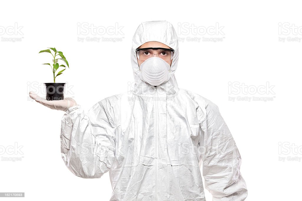 Man in uniform holding a plant royalty-free stock photo