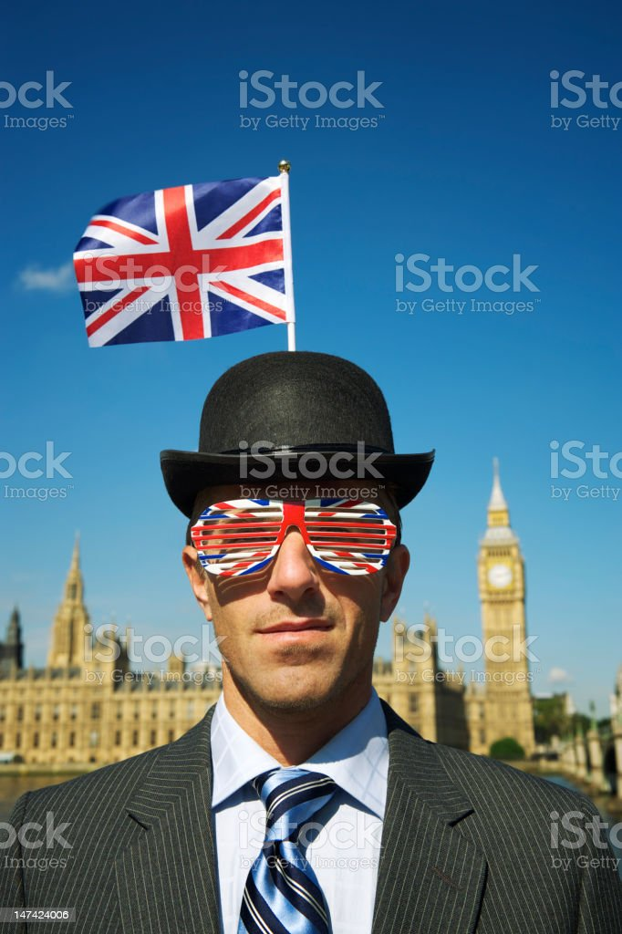 Man in Union Jack Bowler Hat Stands at Westminster London stock photo
