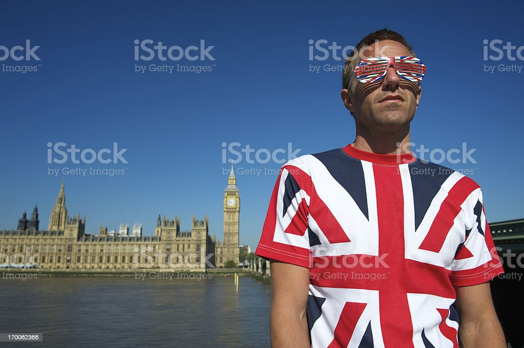 Man in Union Jack T-Shirt and Glasses London Skyline stock photo