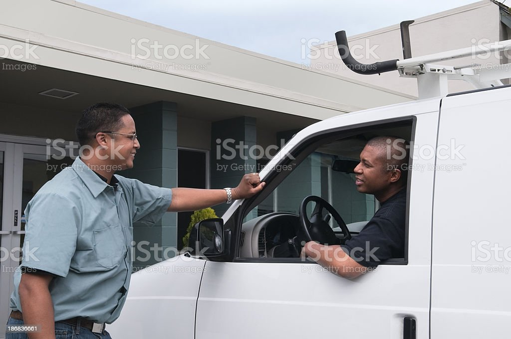Man In Van Talking to a Coworker royalty-free stock photo