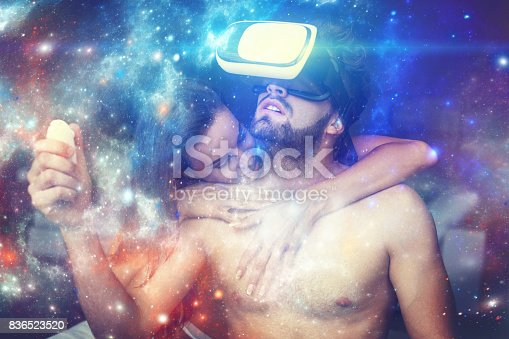 istock Man in VR glasses opening magical universe of fantasy with girlfriend 836523520