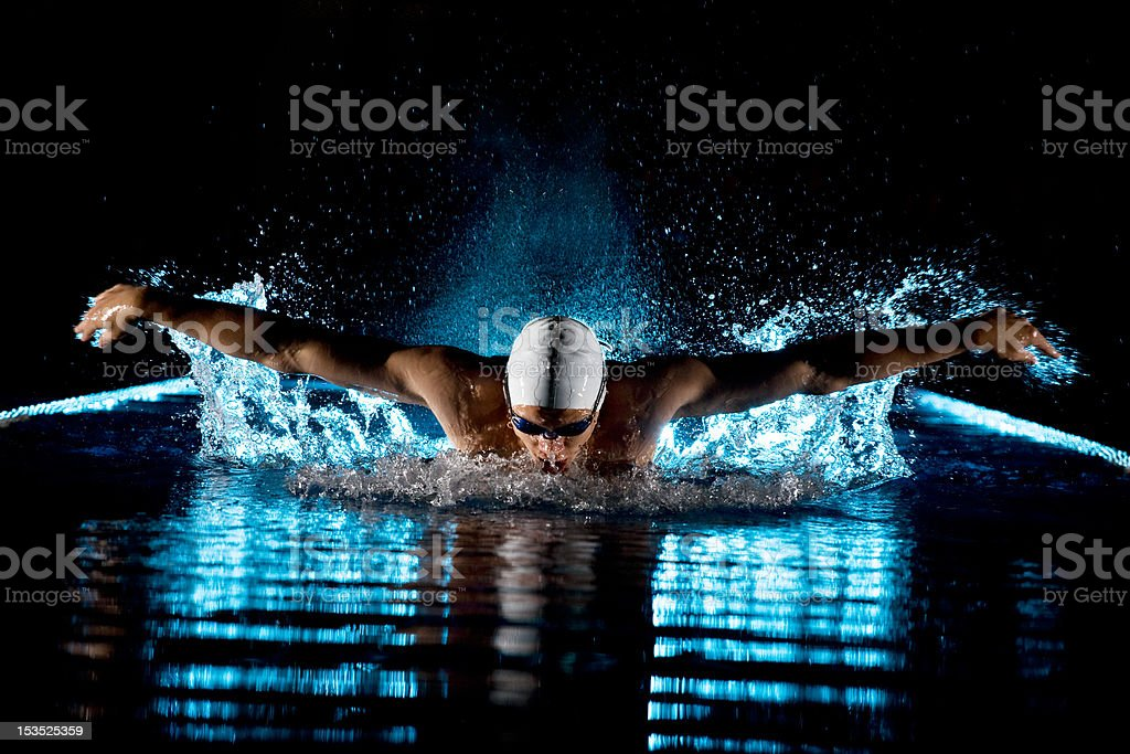 Man in water with arms spread wide royalty-free stock photo