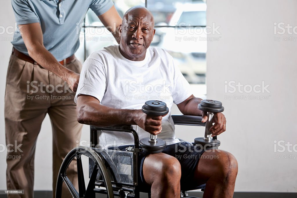 Man in wheelchair doing physical therapy royalty-free stock photo