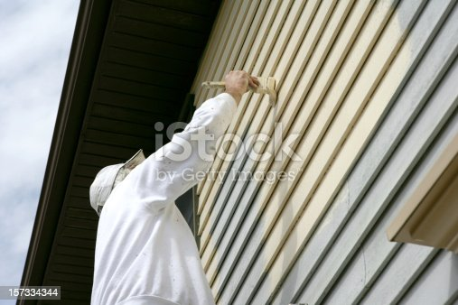 Man In White Coveralls Painting The Outside Of A House Stock Photo & More Pictures of Adult