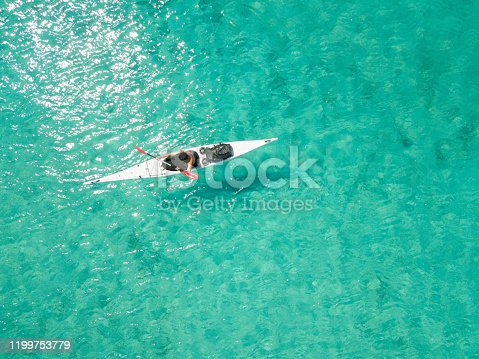 Man in white kayak from above