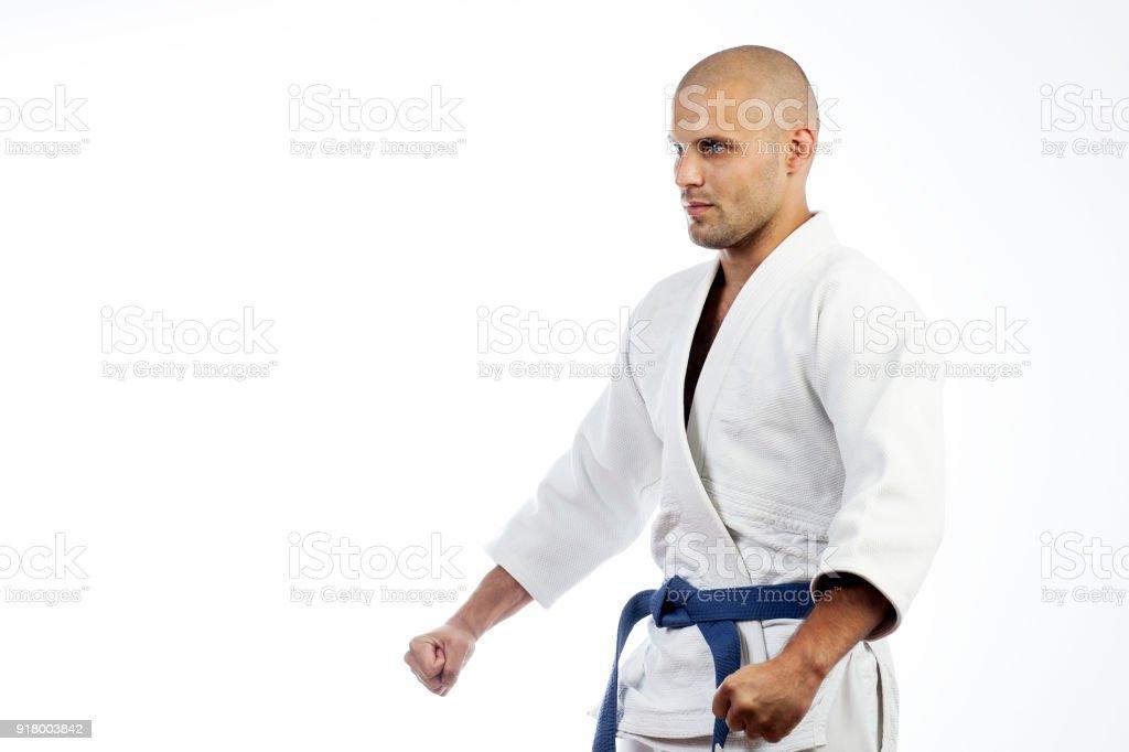 man in white kimono for sambo stock photo