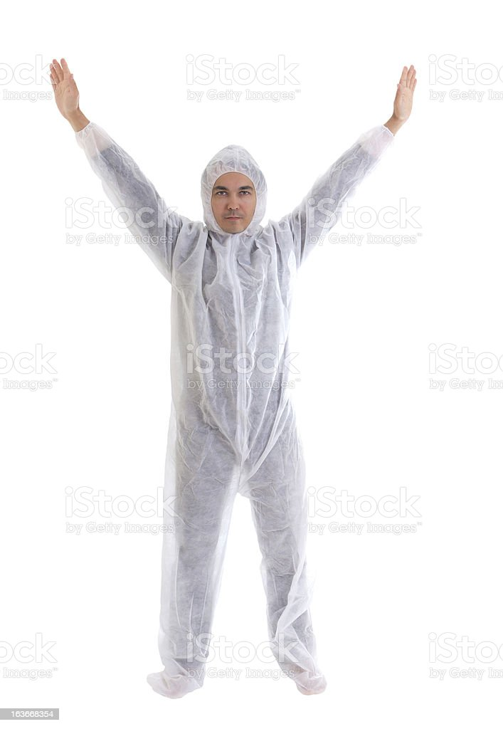 Man in white protective clothes with his hands raised up royalty-free stock photo