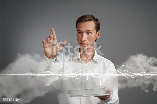 1152920014 istock photo Man in white shirt making magic effect - flash lightning 599121164