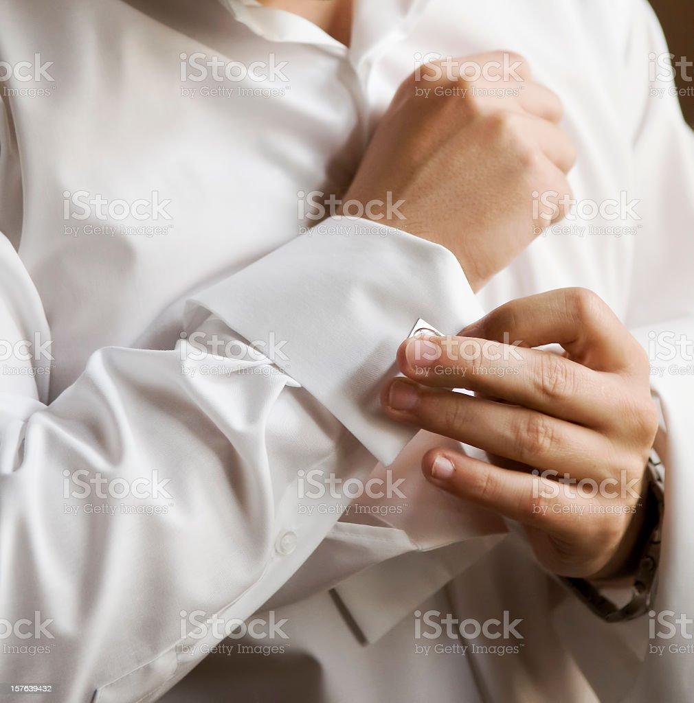 Man in white shirt wearing cufflinks stock photo
