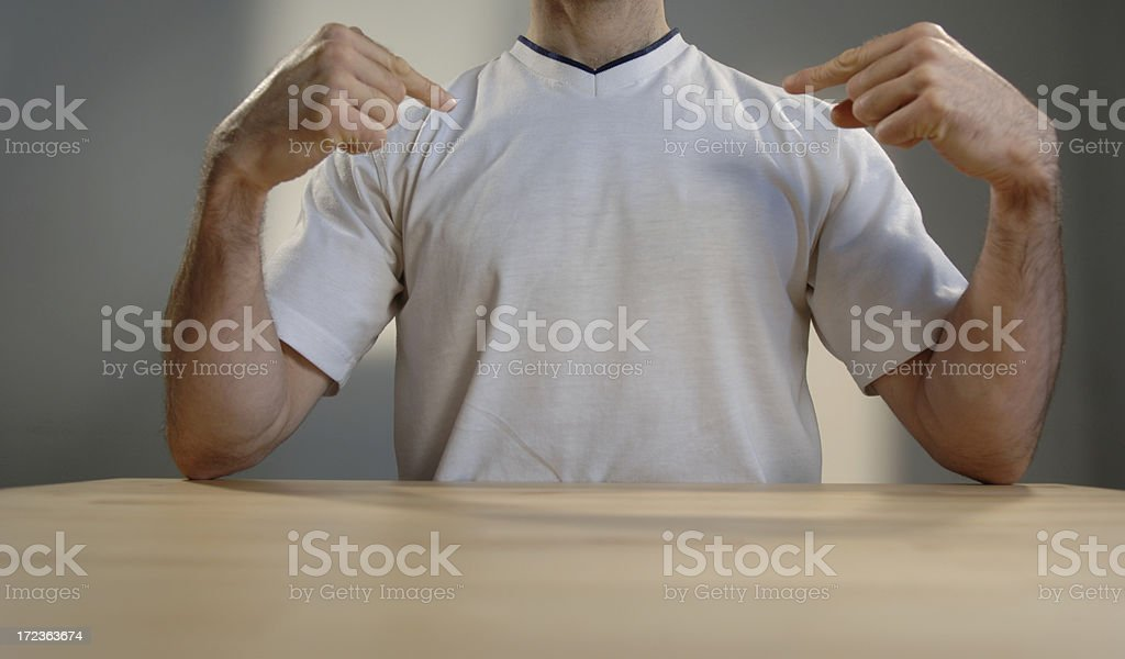 man in white t shirt at table stock photo