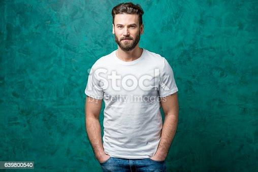 istock Man in white t-shirt 639800540