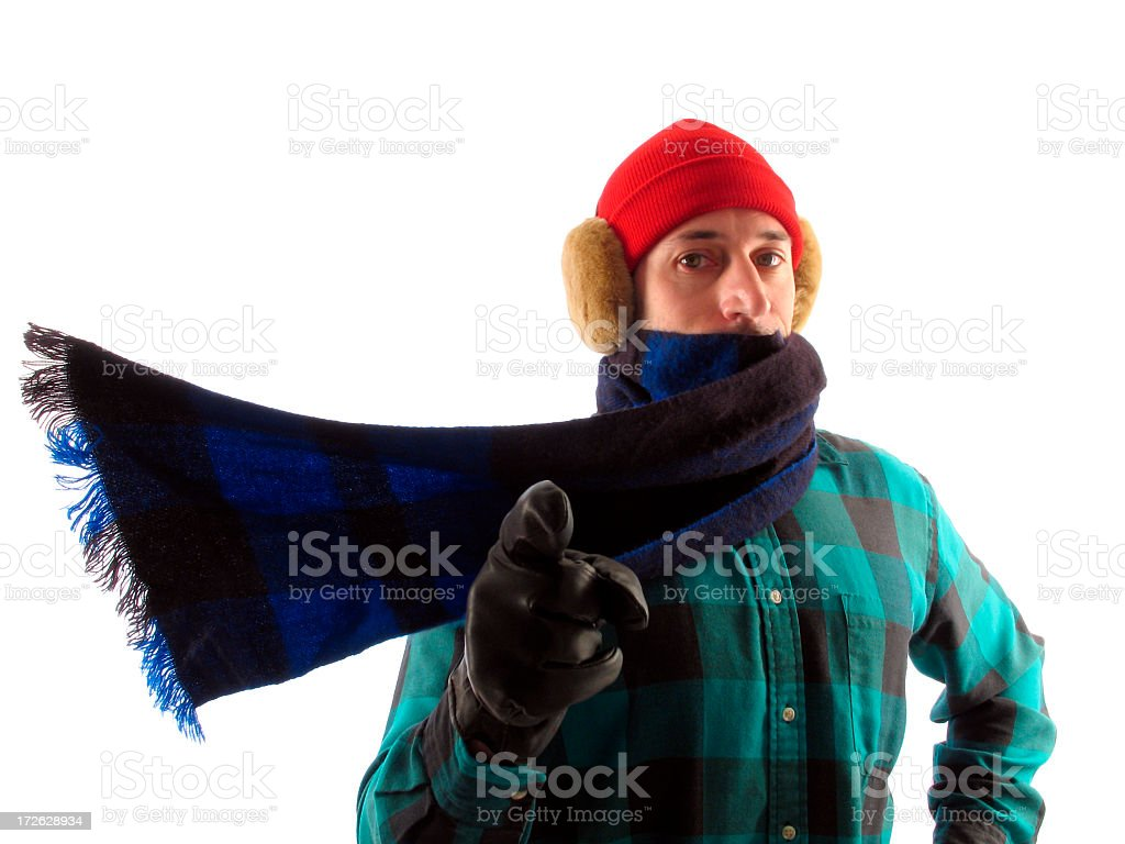 Man in Winter Gear with Blowing Scarf Points at You royalty-free stock photo