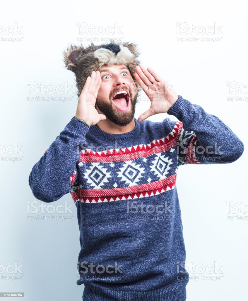 Man in winter wear screaming Portrait of caucasian man screaming on white background. Man in wearing warm clothing. Adult Stock Photo