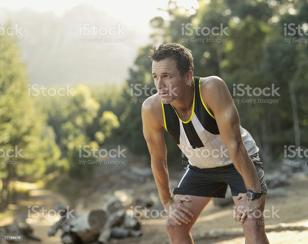 A man in work out gear taking a break royalty-free stock photo