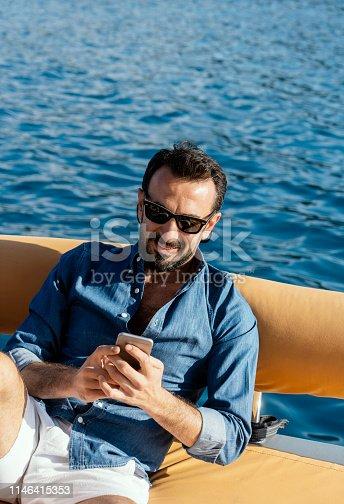 istock Man in yacht enjoying the sea 1146415353