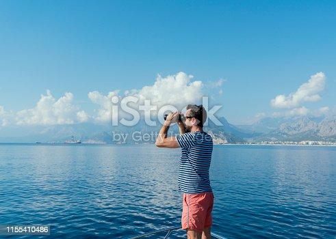 istock Man in yacht enjoying the sea 1155410486