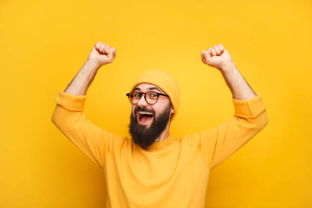 Man in yellow clothes feeling happy stock photo