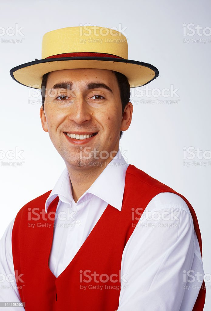 Man in yellow hat and red waistcoat stock photo