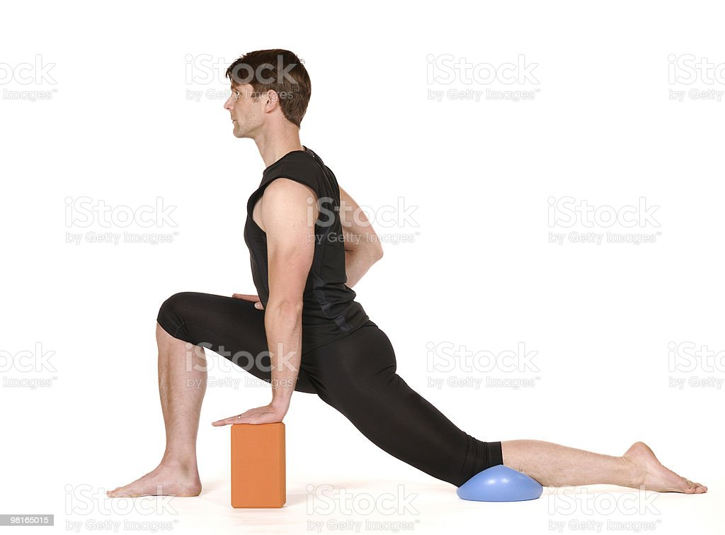 man in yoga postion with ball and brick royalty-free stock photo