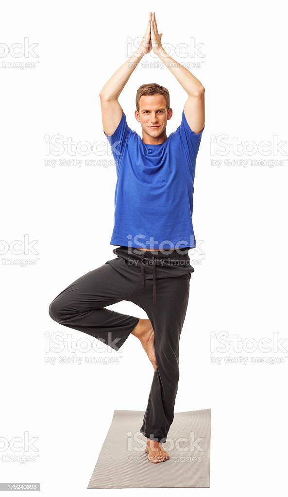 Man In Yoga Tree Pose - Isolated stock photo