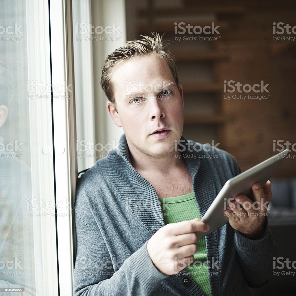 Man indoors with digital tablet royalty-free stock photo
