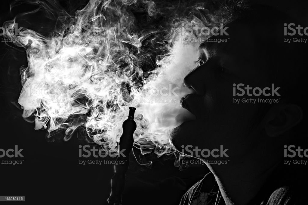Man inhale hookah,B&W stock photo