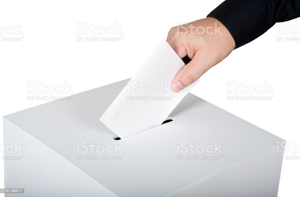 Man inserting a blank vote royalty-free stock photo