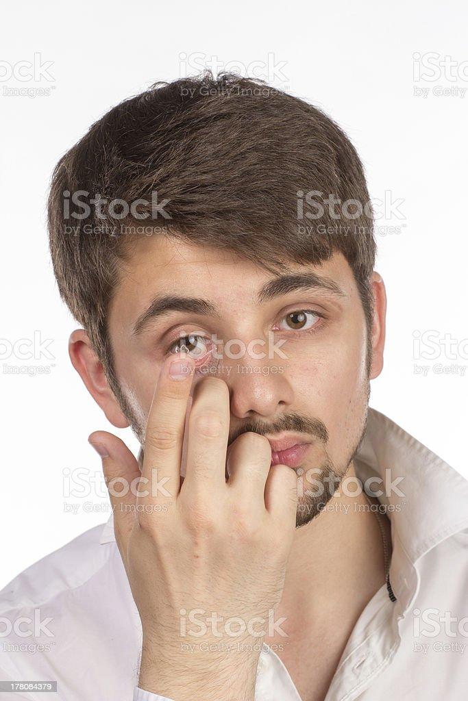 Man inserting  corrective contact lense royalty-free stock photo