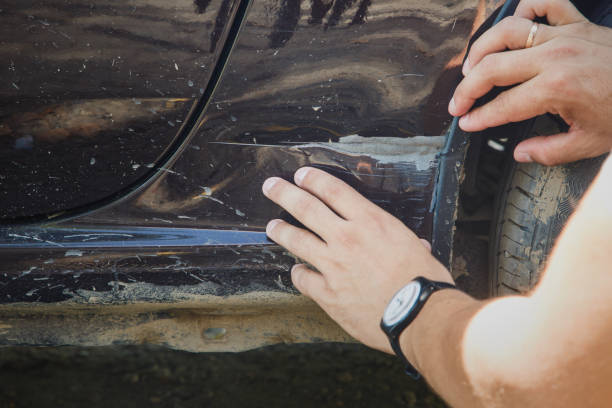 man inspects car t damage - auto body repair stock photos and pictures