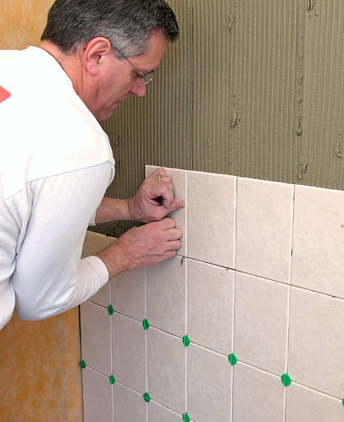 Man installing ceramic tile stock photo