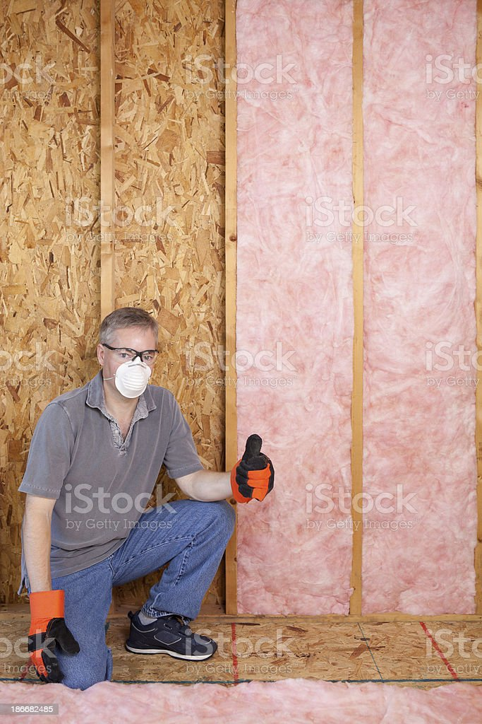 Man installing insulation royalty-free stock photo