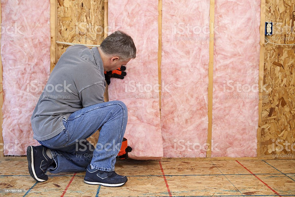Man Installing Insulation stock photo