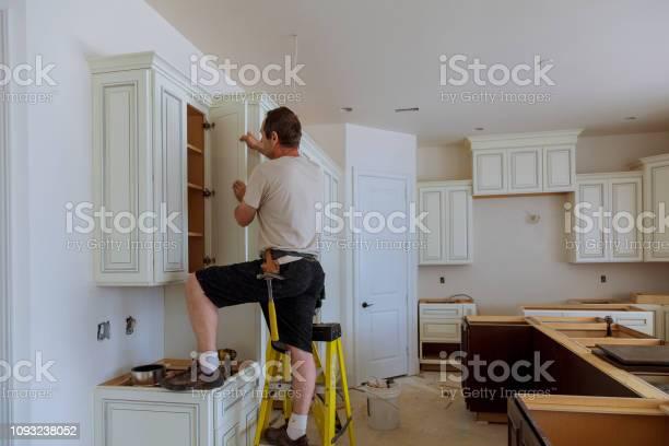 Man installing kitchen cabinets door picture id1093238052?b=1&k=6&m=1093238052&s=612x612&h=w a3dpnzeszbd5n62vhqf2nisjcgdhq0ku58yekksvu=