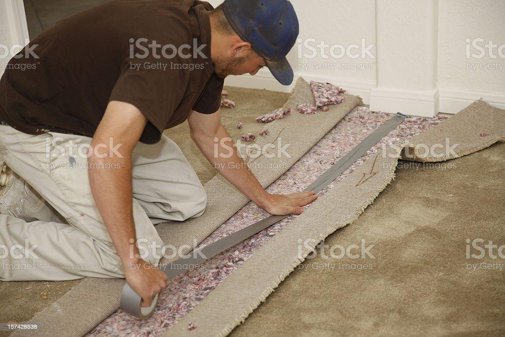 Man Installing New Carpet stock photo