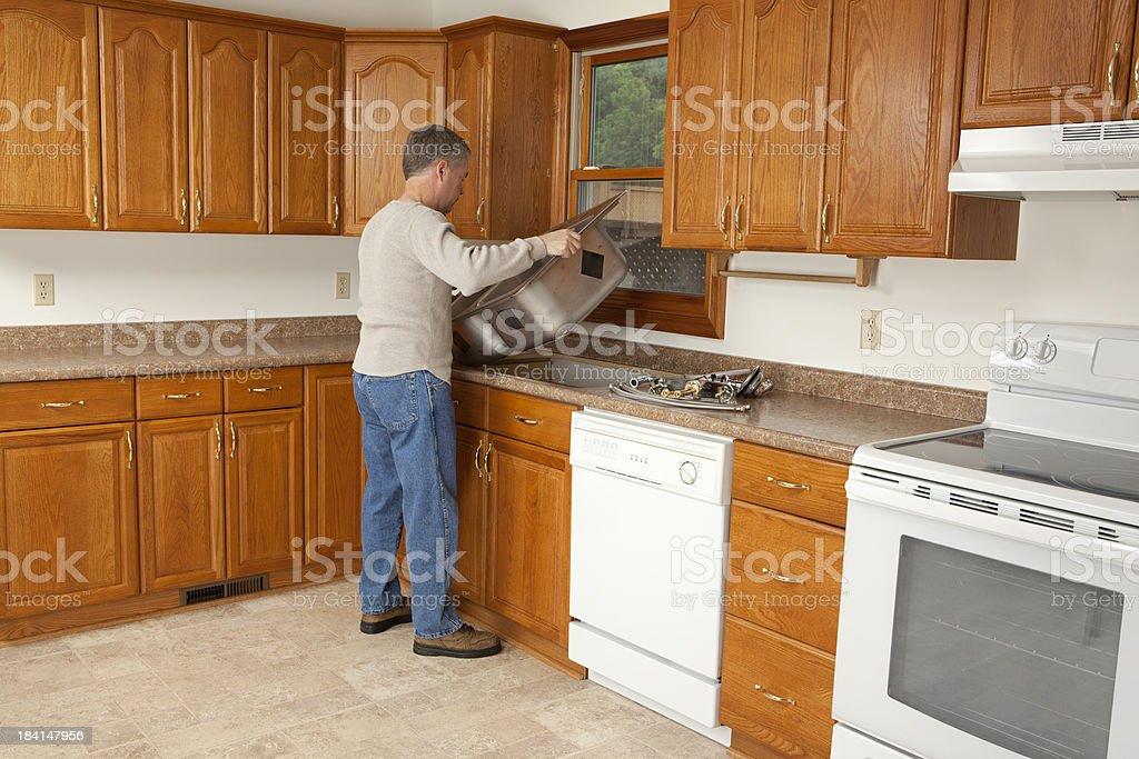 Man Installing New Kitchen Sink royalty-free stock photo